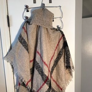 Poncho with turtle neck